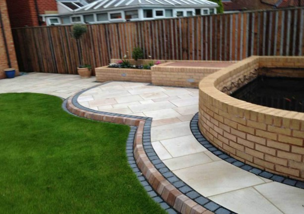 Caramel Cream Patio Paving & Natural Turf Project
